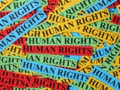 "Pile of colorful paper notes with words ""Human Rights"". Human rights concept."