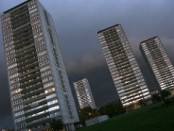 High-rise blocks. Glasgow housing scheme, in cloudy dusk sky. Inner city/urban deprivation.